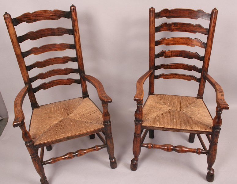 A Good Set of 12 Antique Ladder Back Country Chairs