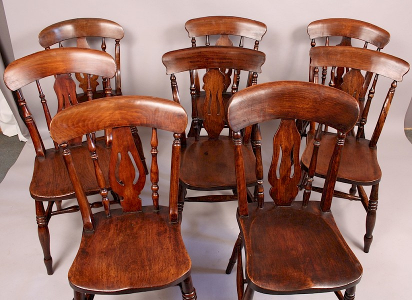 A Harlequin Set of 8 Victorian Kitchen Chairs