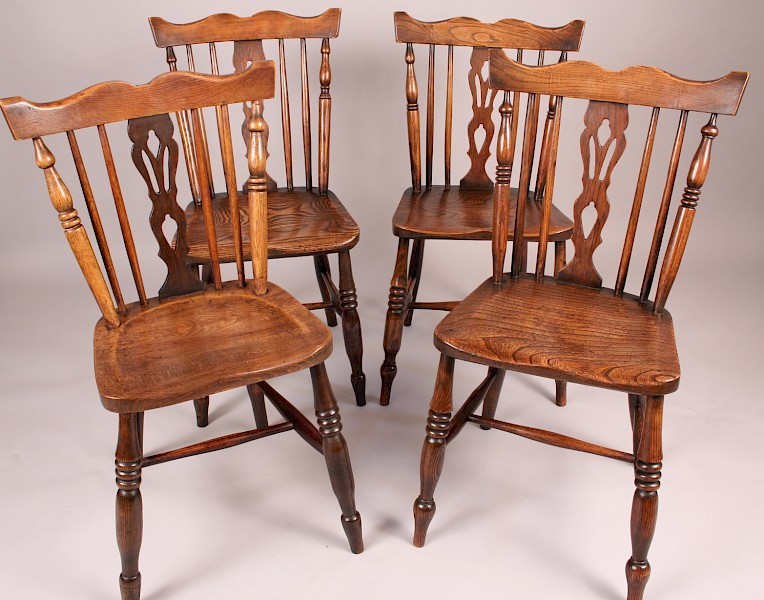 An Attractive Harlequin set of Kitchen Chairs