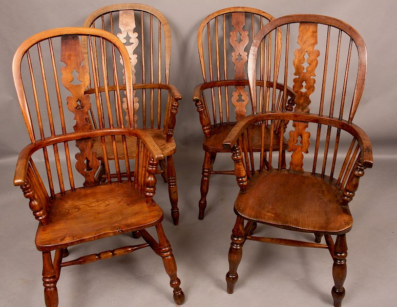 A Harlequin Set of Four Windsor Chairs