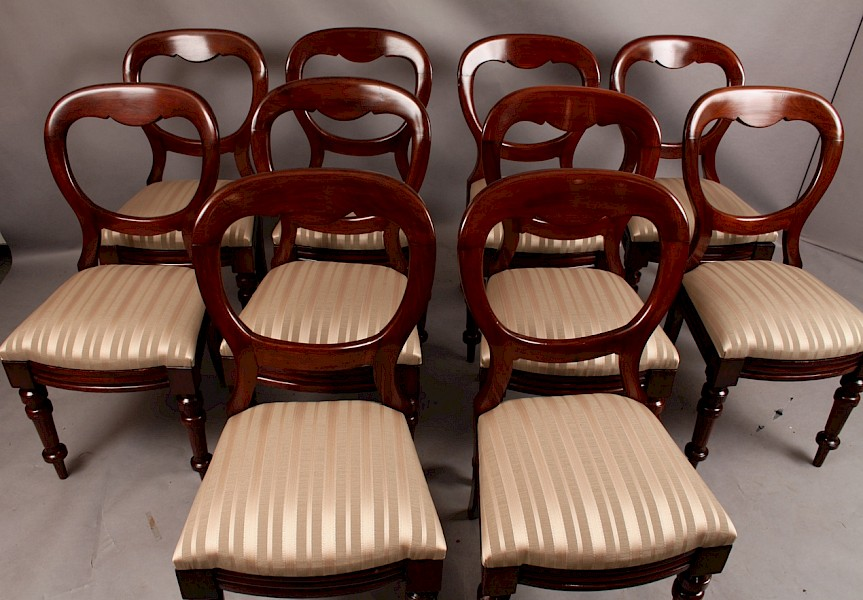 A Set of Ten Victorian Balloon Back Dining Chairs