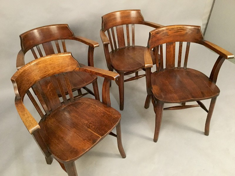A Set of Four Captains Chairs