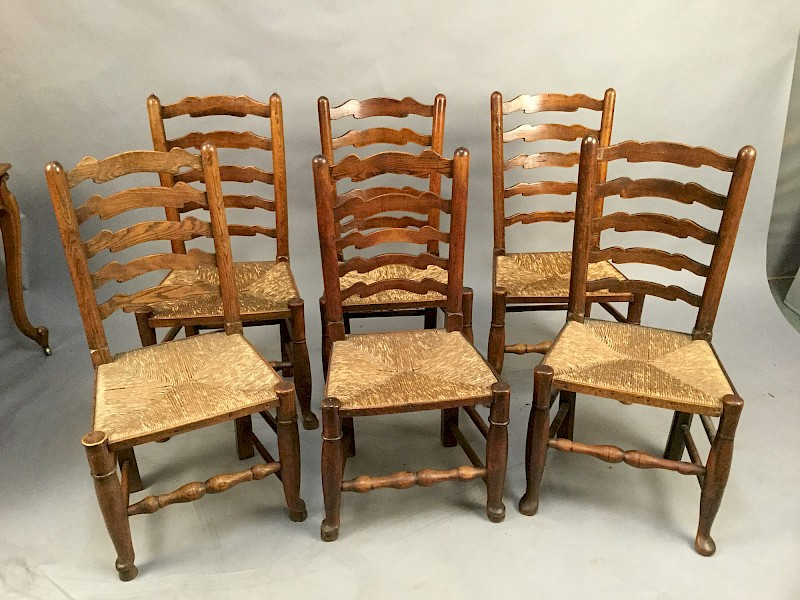 A Harlequin Set of 6 19th Century Ladder Back Dining Chairs
