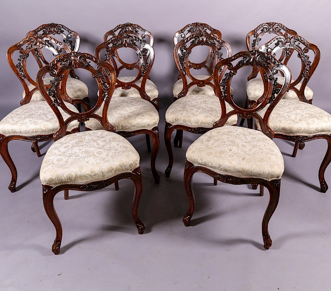 A Set of 10 Victorian Walnut Dining Chairs