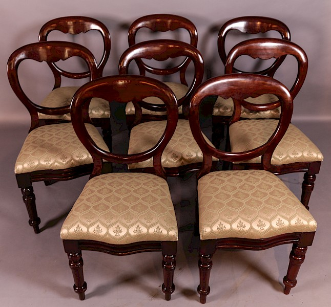 A Set of 8 Victorian Mahogany Balloon Back Dining Chairs
