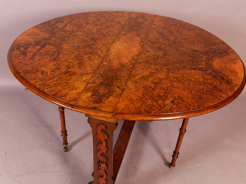 A Victorian Burr Walnut Sutherland Table