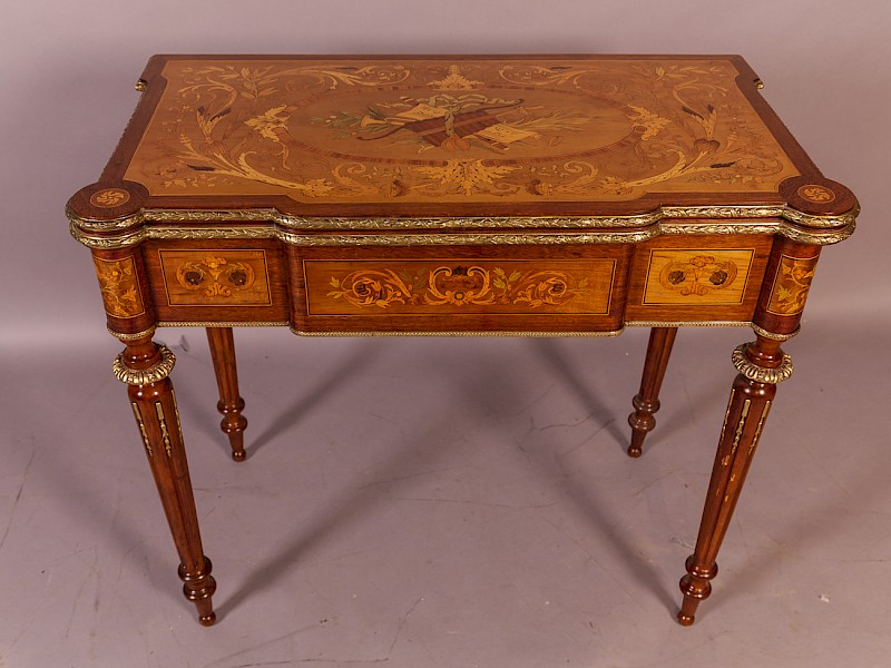 A Stunning French Games Table with Marquetry Inlay of the finest quality,