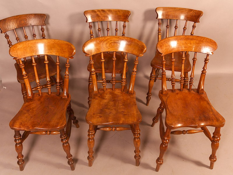 A Harlequin set of 6 Ash and Elm Kitchen Chairs