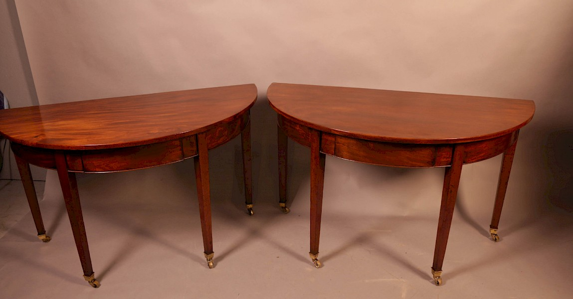 A pair of 18th century Demi Lune hall tables