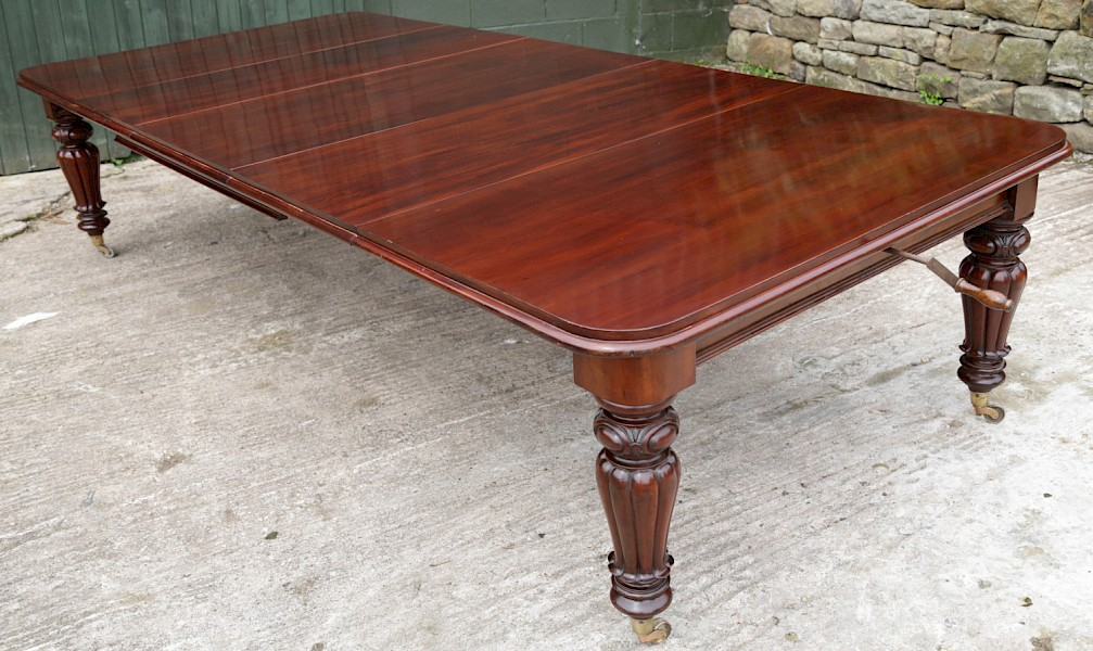 Early Victorian Mahogany Wind Out Extening Dining Table seats 12