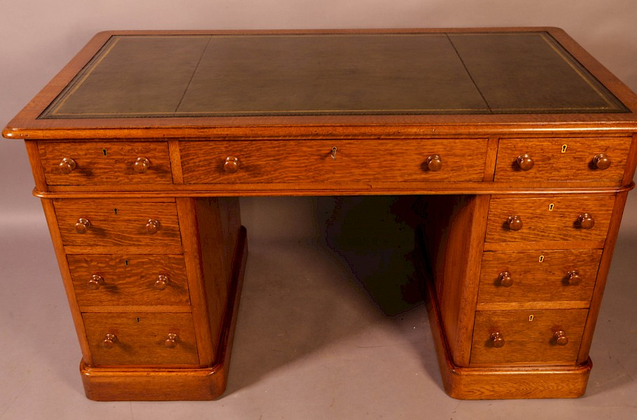 A Victorian Pedestal Desk in Golden Oak